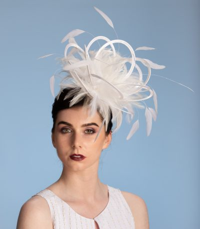 white satin loop and feather fascinator hat set on a headband