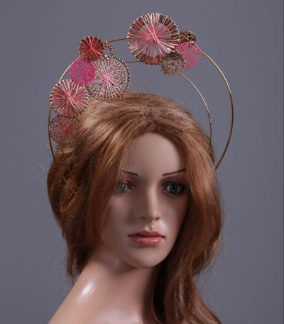 Pink disc gold halo crown fascinator hat