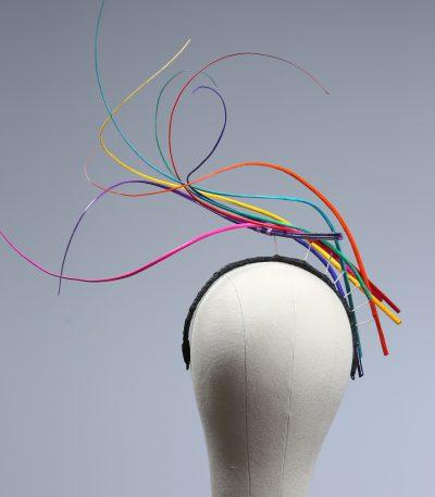 Rainbow multi-coloured quill floating fascinator hat set on a headband