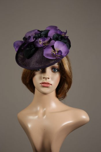Aubergine sinamay saucer fascinator hatinator hat with purple and black orchid flowers
