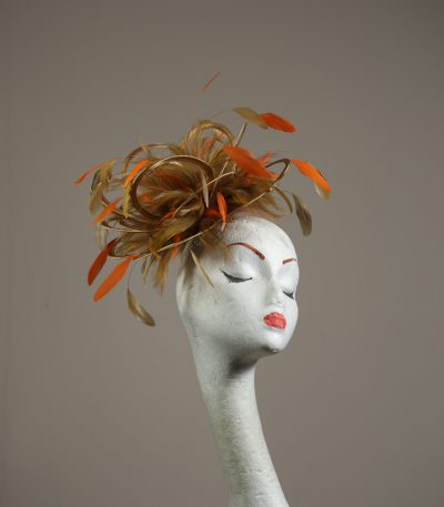 Gold satin Loop Fascinator Hat with gold and orange feathers