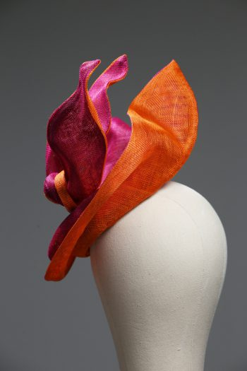 Hot Pink sinamay saucer hat set on a orange button pillbox fascinator