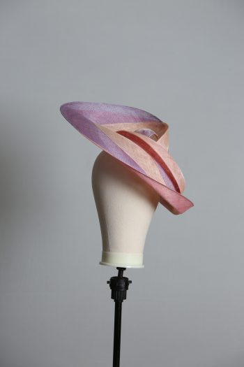 Pink lilac and oyster sinamay swirl fascinator hat set on a teardrop base